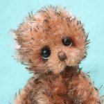 small artist teddy bear